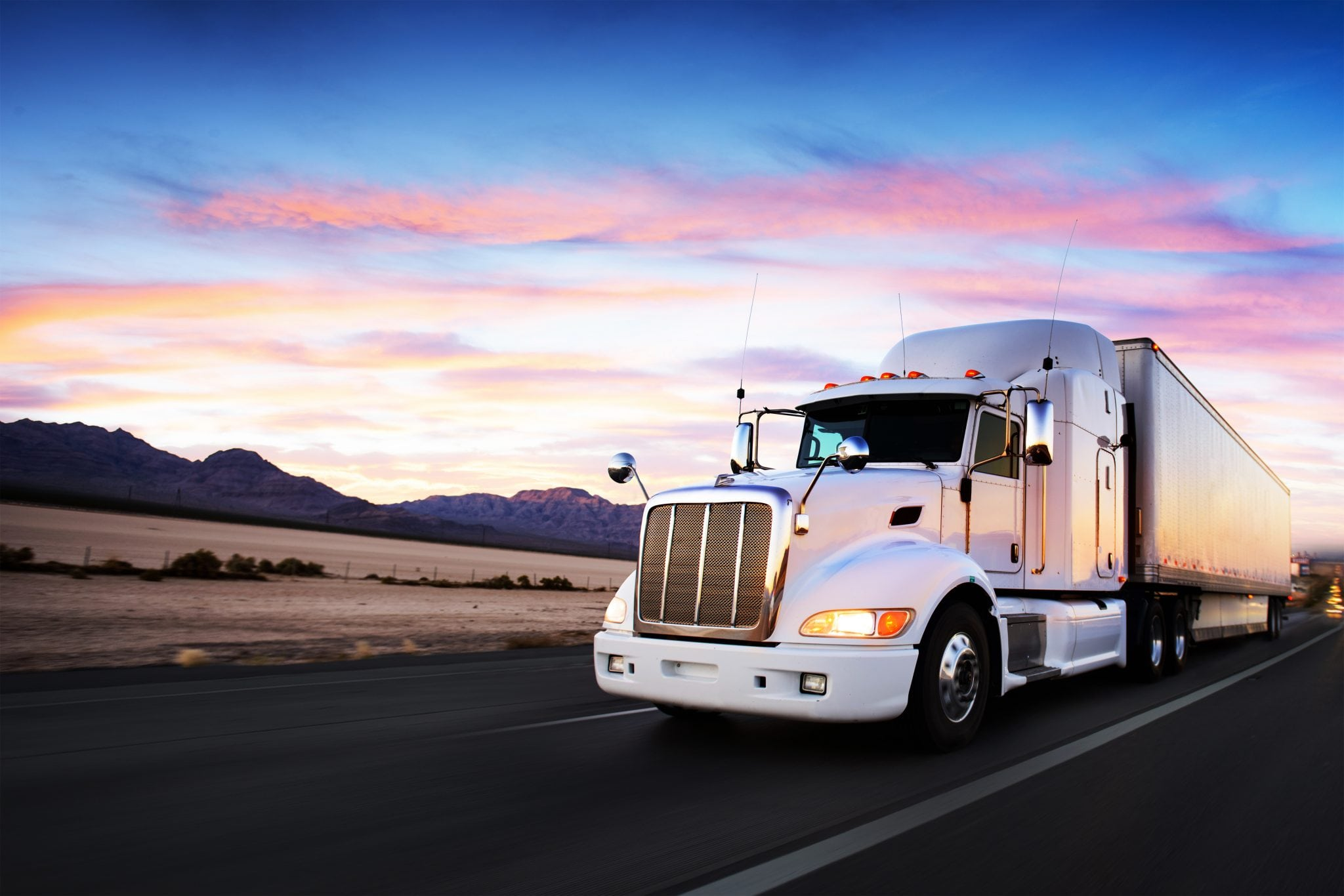 commercial Truck and highway at sunset - transportation background