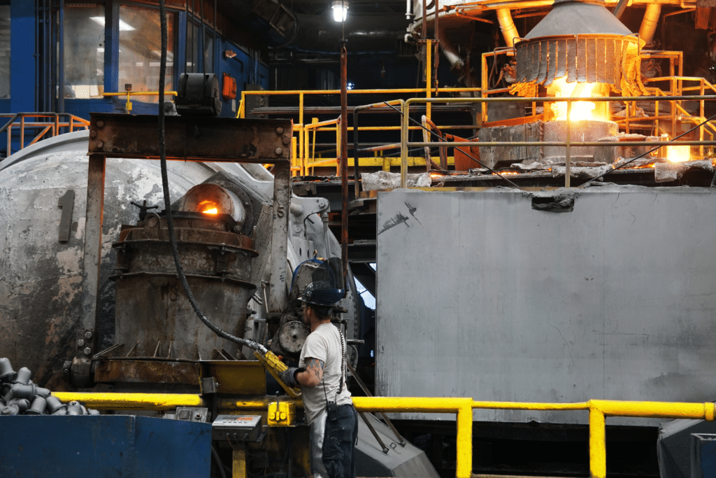Holding furnace 1 with foundry and cupola in the background