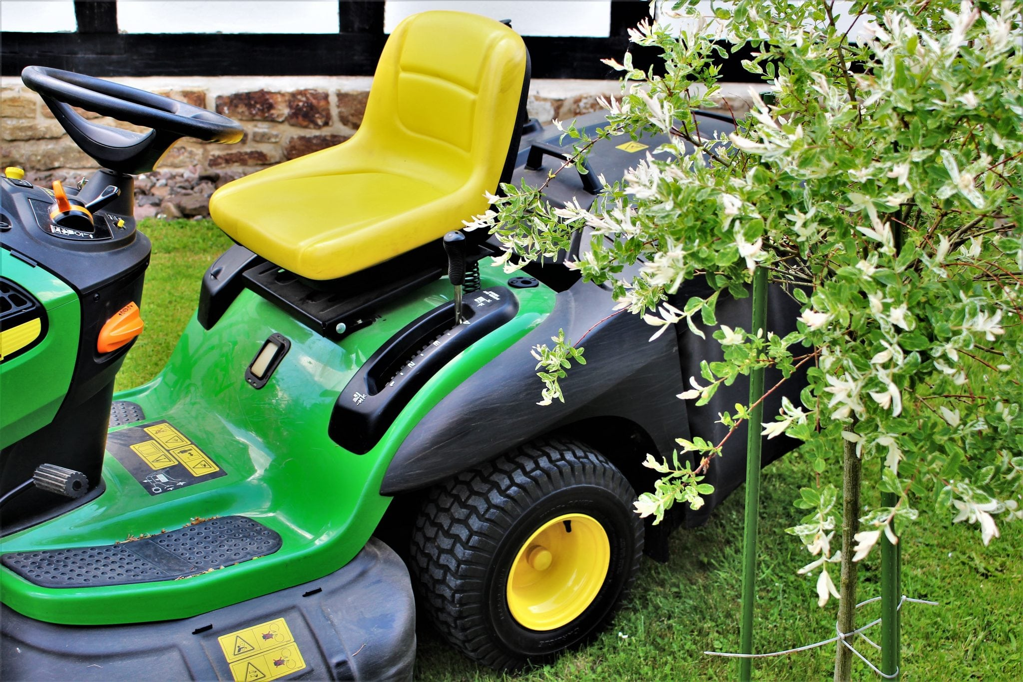 image of green lawn tractor mowing lawn