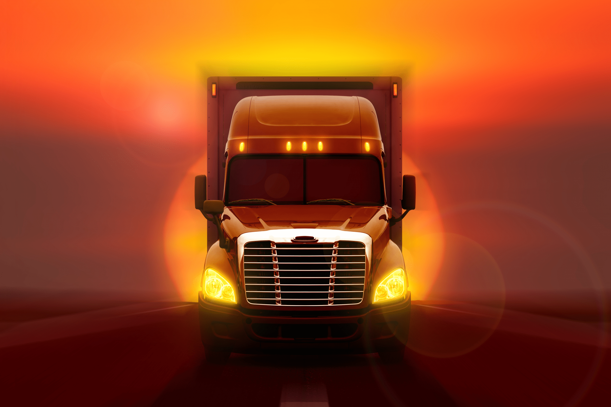 Front of a commercial semi-truck with sunset behind it