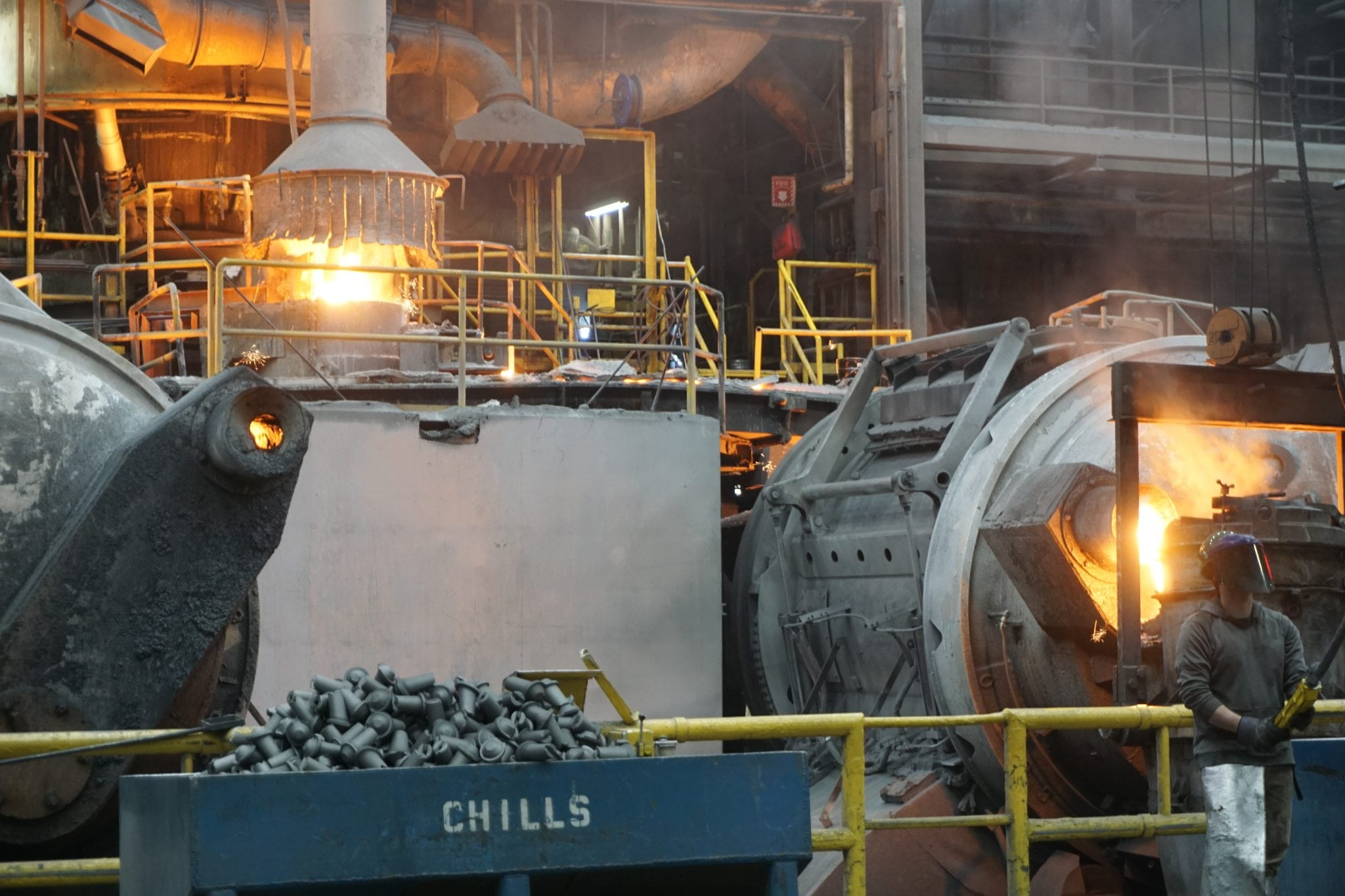 Cadillac casting cupola furnace, chills and holding tank 2 with worker. innovative leader of ductile iron castings.
